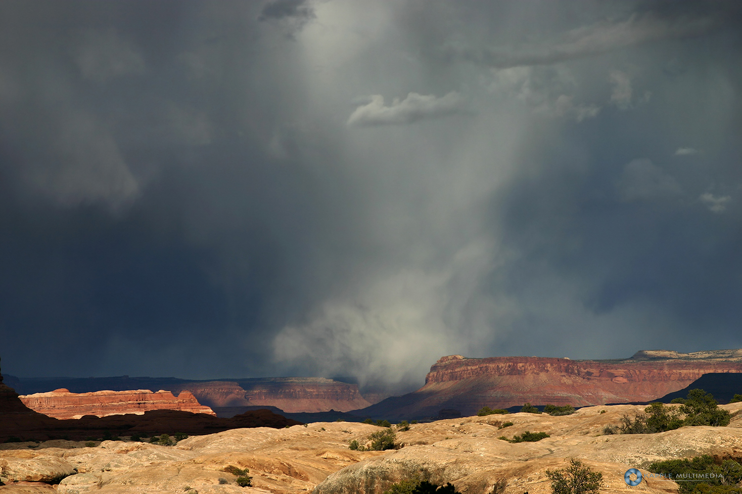 Storm gathering over the Needles District of the Canyonlands National Park, Utah, USA