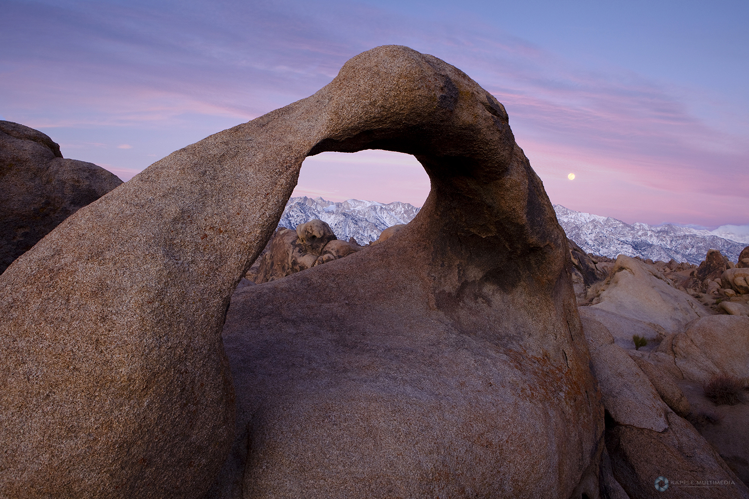 Sunrise at Mobius Arch in the Alabama Hills with the Sierras in the background. Alabama Hills, Lone Pine, California, USA.