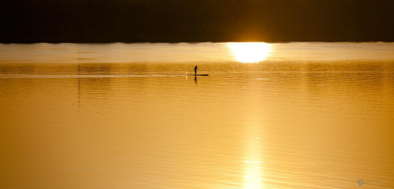 Lone Kayaker during sunset at White Rock Lake, Dallas, Texas